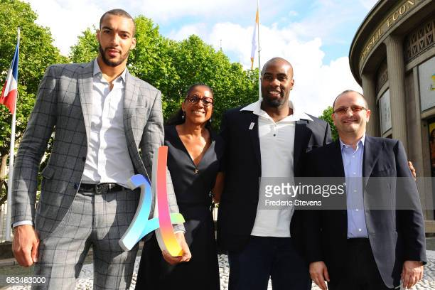 Evaluation Commission Chairman Patrick Baumann poses with the athletes Rudy Gobert Marie Josee Perec and Teddy Riner in front in Paris on May 15 2017...