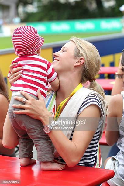 EvaMaria Grein and her baby son Jonathan during the charity football game 'Kick for Kids' to benefit 'Die Seilschaft zusammen sind wir stark eV' at...