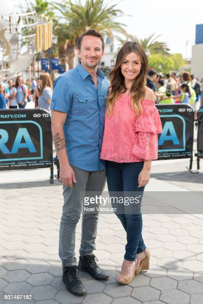 Evan Bass and Carly Waddell visit 'Extra' at Universal Studios Hollywood on August 14 2017 in Universal City California