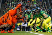 Evan Bayliss of the Oregon Ducks guards Jabral Johnson of the Oregon State Beavers during the 117th playing of the Civil War on Novemeber 29 2013 at...