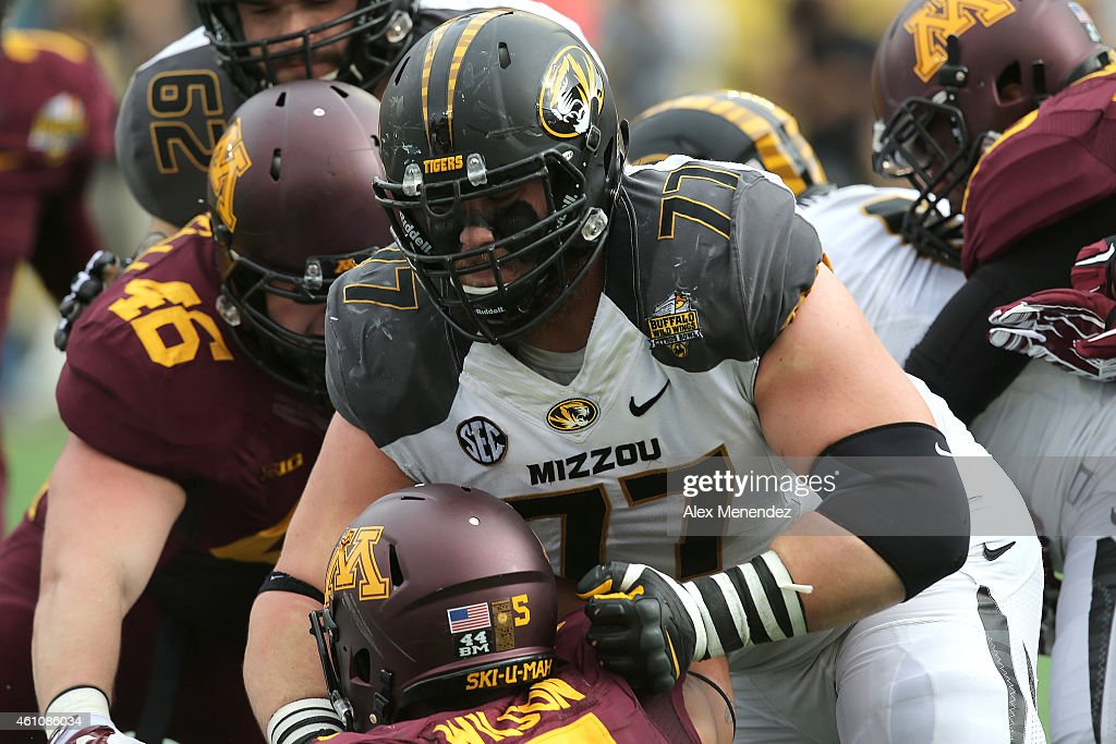 <a gi-track='captionPersonalityLinkClicked' href=/galleries/search?phrase=Evan+Boehm&family=editorial&specificpeople=9839229 ng-click='$event.stopPropagation()'>Evan Boehm</a> #77 of the Missouri Tigers is seen during the Buffalo Wild Wings Citrus Bowl between the Minnesota Golden Gophers and the Missouri Tigers at the Florida Citrus Bowl on January 1, 2015 in Orlando, Florida.