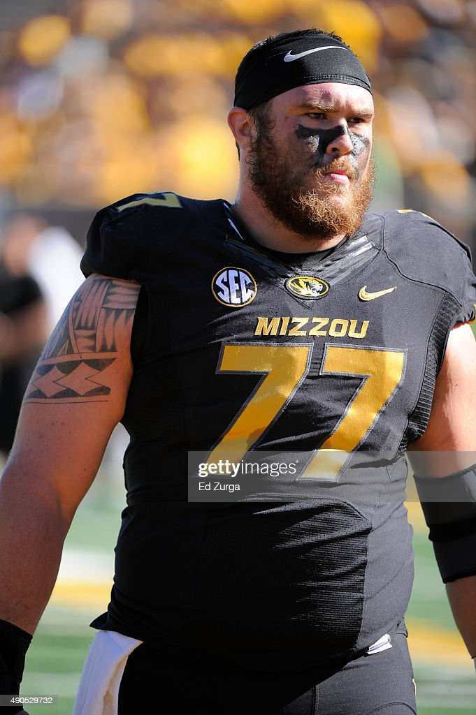 <a gi-track='captionPersonalityLinkClicked' href=/galleries/search?phrase=Evan+Boehm&family=editorial&specificpeople=9839229 ng-click='$event.stopPropagation()'>Evan Boehm</a> #77 of the Missouri Tigers warms up prior to a game against the Connecticut Huskies at Memorial Stadium on September 19, 2015 in Columbia, Missouri.