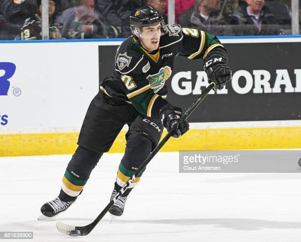 Evan Bouchard of the London Knights makes a pass against the Guelph Storm during an OHL game at Budweiser Gardens on March 9 2017 in London Ontario...
