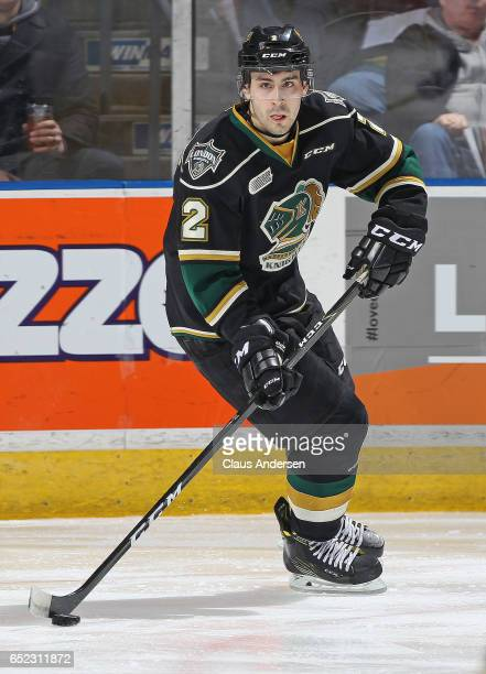 Evan Bouchard of the London Knights skates with the puck against the Erie Otters during an OHL game at Budweiser Gardens on March 10 2017 in London...