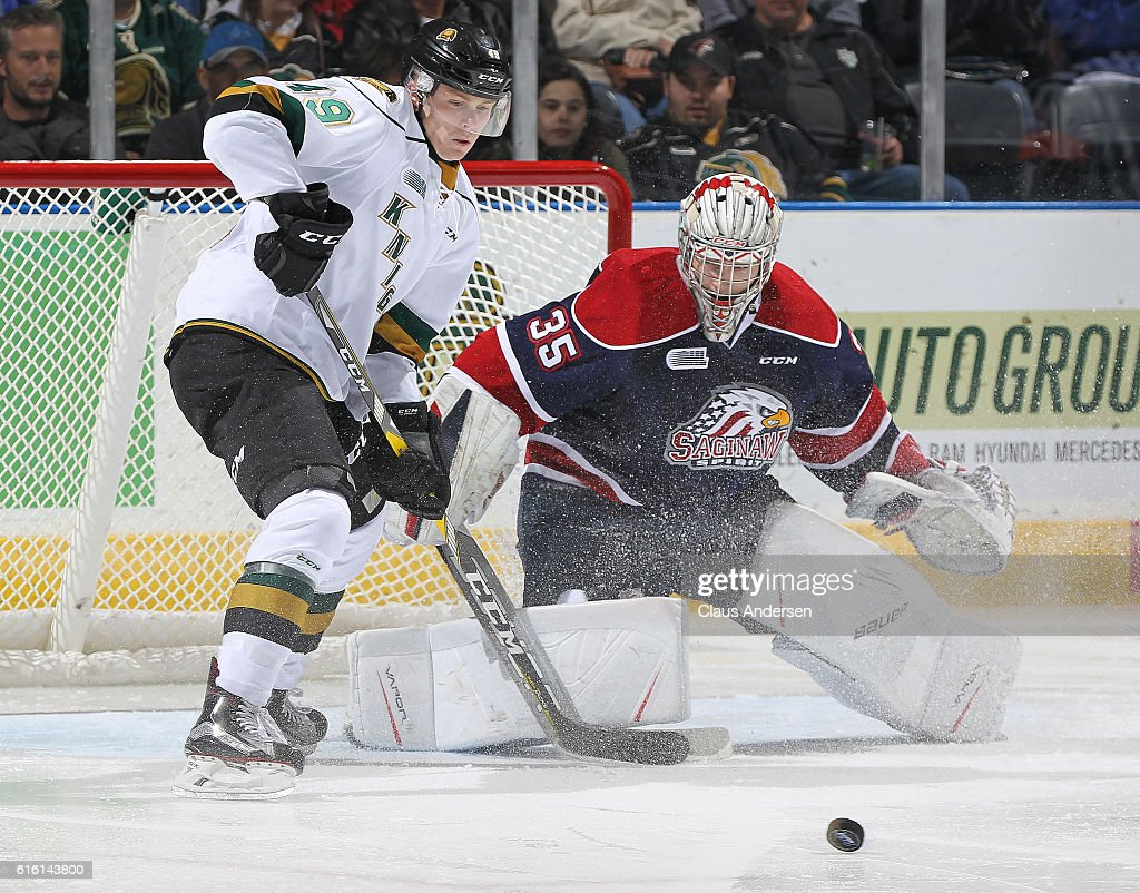 Evan Cormier #35 of the Saginaw Spirit looks to stop a tip in by Max Jones #49 of the London Knights during an OHL game at Budweiser Gardens on October 21, 2016 in London, Ontario, Canada. The Knights defeated the Spirit 5-1.