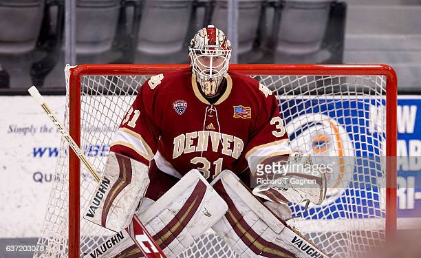 Evan Cowley of the Denver Pioneers warms up prior to an NCAA hockey game against the Providence College Friars at the Schneider Arena on December 30...