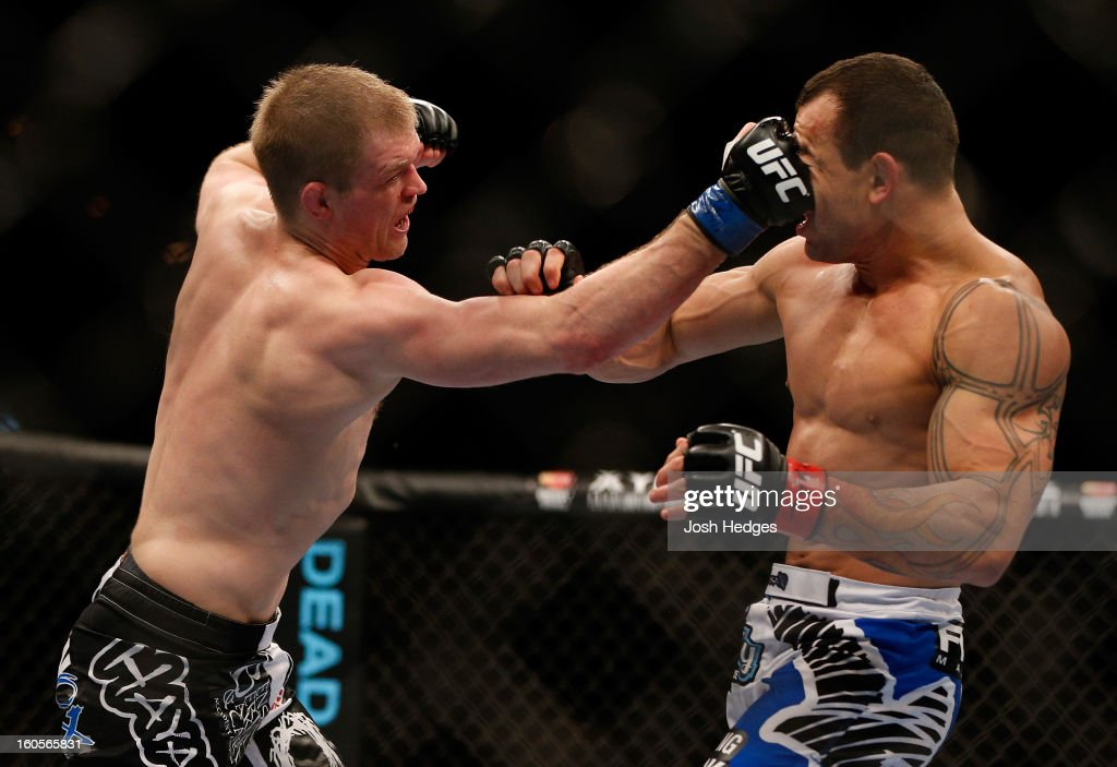 Evan Dunham punches Gleison Tibau during their lightweight fight at UFC 156 on February 2, 2013 at the Mandalay Bay Events Center in Las Vegas, Nevada.