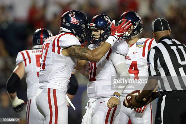 Evan Engram celebrates with Chad Kelly of the Mississippi Rebels after scoring a touchdown in the second quarter against the Florida State Seminoles...