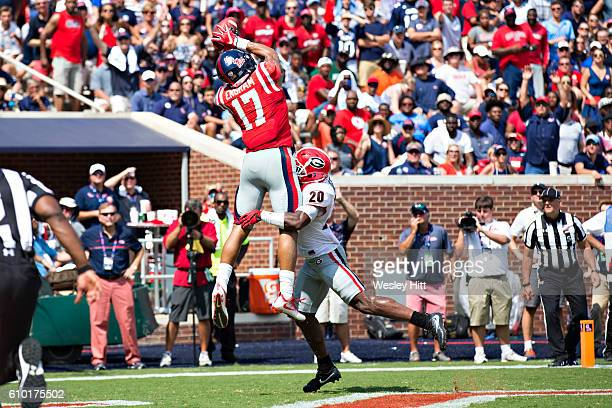 Evan Engram of the Mississippi Rebels catches a touchdown pass while being defended by Quincy Mauger of the Georgia Bulldogs at VaughtHemingway...