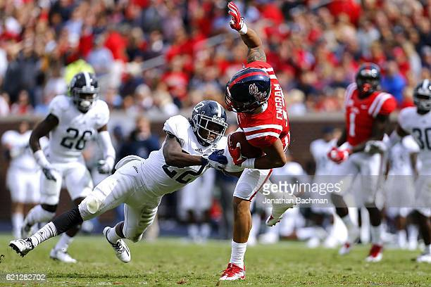 Evan Engram of the Mississippi Rebels cateches the ball as Joshua Moon of the Georgia Southern Eagles defends during the first half of a game at...