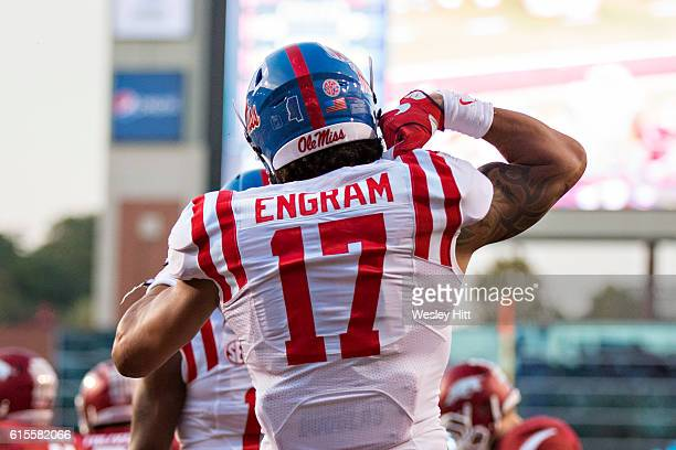 Evan Engram of the Mississippi Rebels celebrates after scoring a touchdown during a game against the Arkansas Razorbacks at Razorback Stadium on...