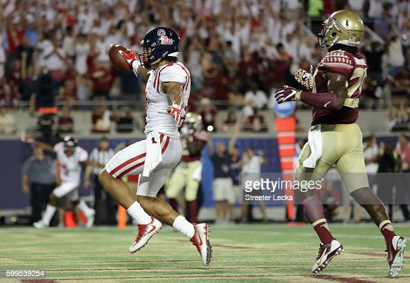 Evan Engram of the Mississippi Rebels celebrates scoring a touchdown in the second quarter against the Florida State Seminoles during the Camping...