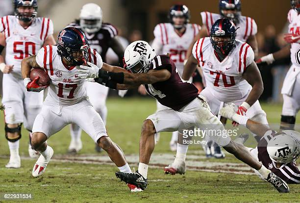 Evan Engram of the Mississippi Rebels fends off Justin Evans of the Texas AM Aggies in the fourth quarter at Kyle Field on November 12 2016 in...