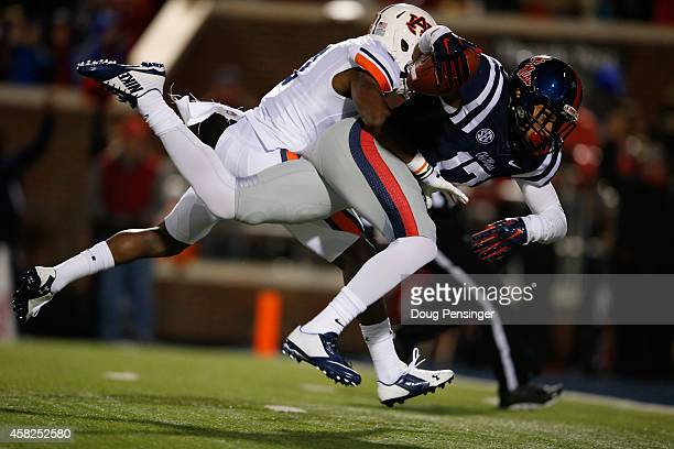 Evan Engram of the Mississippi Rebels makes a 50 yard touchdown reception against Jonathan Jones of the Auburn Tigers to take a 2414 lead in the...