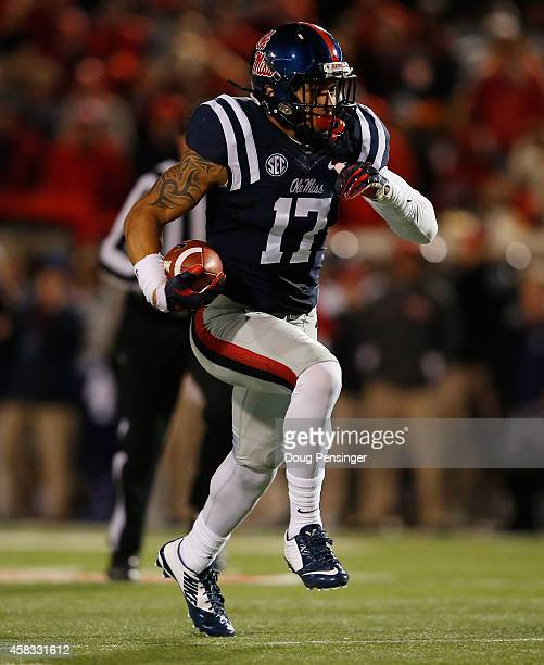 Evan Engram of the Mississippi Rebels makes a reception against the Auburn Tigers at VaughtHemingway Stadium on November 1 2014 in Oxford Mississippi...