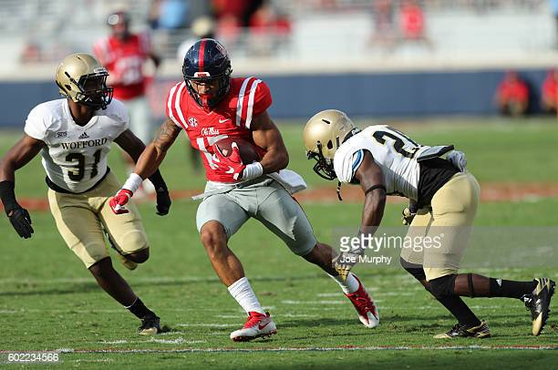 Evan Engram of the Mississippi Rebels runs after the catch against Malik Rivera the Wofford Terriers on September 10 2016 at VaughtHemingway Stadium...