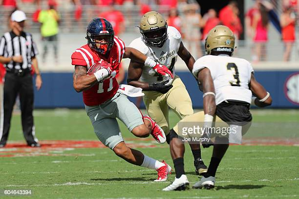 Evan Engram of the Mississippi Rebels runs after the catch against Jolo Tilery of the Wofford Terriers on September 10 2016 at VaughtHemingway...