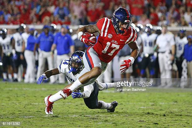 Evan Engram of the Mississippi Rebels runs for a touchdown past Jonathan Cook of the Memphis Tigers during the second half of a game at...