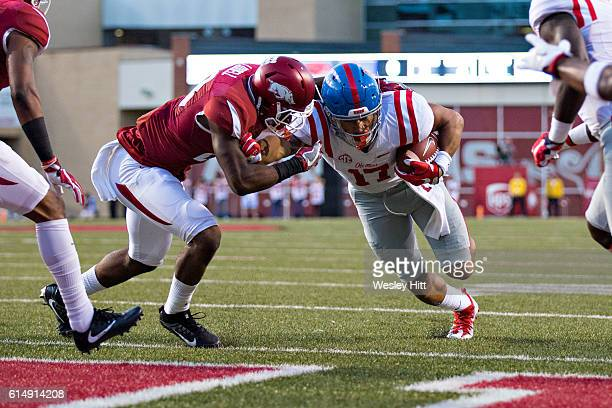 Evan Engram of the Mississippi Rebels runs the ball in for a touchdown in the first quarter during a game against the Arkansas Razorbacks at...