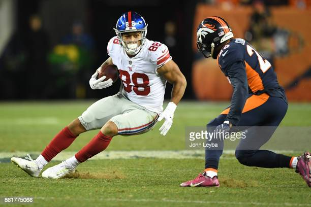 Evan Engram of the New York Giants stops and makes a move while running with the ball in the third quarter against the Denver Broncos The Denver...