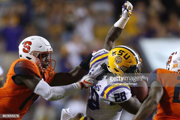 Evan Foster of the Syracuse Orange tackles Darrel Williams of the LSU Tigers during the second half of a game at Tiger Stadium on September 23 2017...