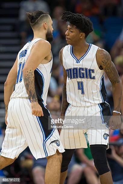 Evan Fournier and Elfrid Payton of the Orlando Magic celebrate with a chest bump during the game against the LA Clippers at Amway Center on December...