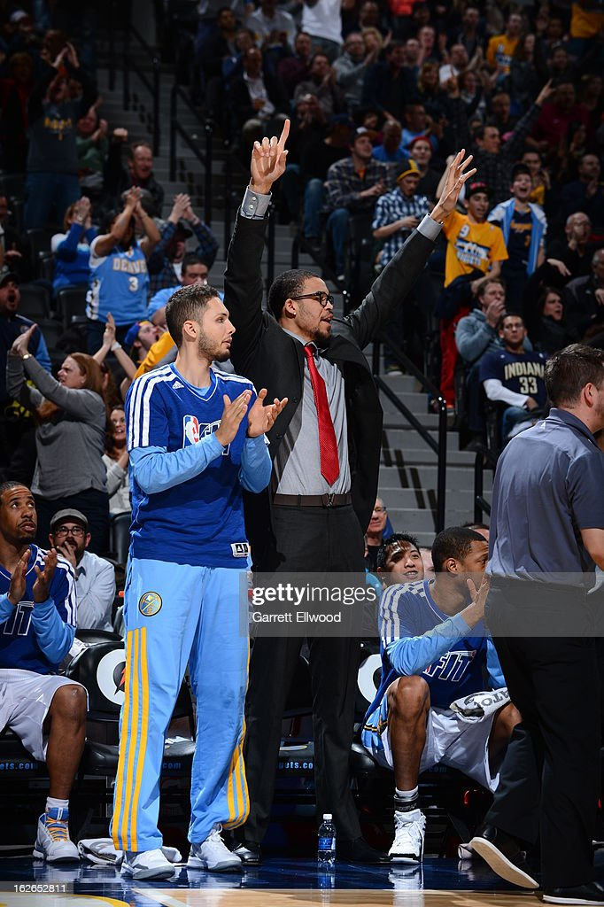 Evan Fournier #94 and JaVale McGee #34 of the Denver Nuggets celebrate a play from the bench during the game against the Indiana Pacers on January 28, 2013 at the Pepsi Center in Denver, Colorado.