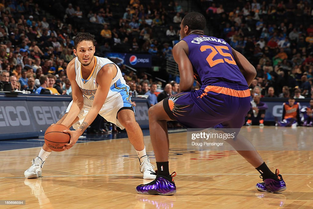 <a gi-track='captionPersonalityLinkClicked' href=/galleries/search?phrase=Evan+Fournier&family=editorial&specificpeople=7285162 ng-click='$event.stopPropagation()'>Evan Fournier</a> #94 of the Denver Nuggets controls the ball against <a gi-track='captionPersonalityLinkClicked' href=/galleries/search?phrase=Dionte+Christmas&family=editorial&specificpeople=4091611 ng-click='$event.stopPropagation()'>Dionte Christmas</a> #25 of the Phoenix Suns during preseason action at Pepsi Center on October 23, 2013 in Denver, Colorado. The Suns defeated the Nuggets 98-79.