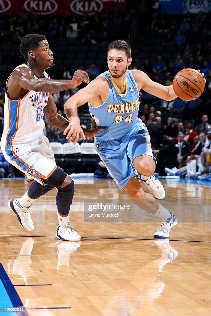 Evan Fournier #94 of the Denver Nuggets drives against DeAndre Liggins #25 of the Oklahoma City Thunder on January 16, 2013 at the Chesapeake Energy Arena in Oklahoma City, Oklahoma.