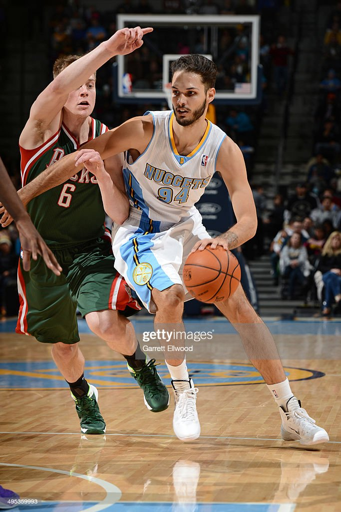 Evan Fournier #94 of the Denver Nuggets drives to the basket against Nate Wolters #6 of the Milwaukee Bucks on February 5, 2014 at the Pepsi Center in Denver, Colorado.