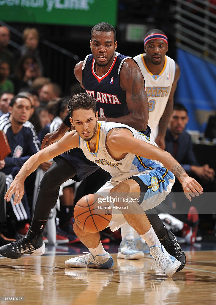 Evan Fournier #94 of the Denver Nuggets goes after the ball against the Atlanta Hawks on November 7, 2013 at the Pepsi Center in Denver, Colorado.