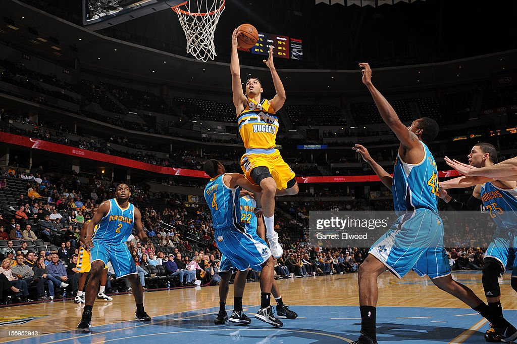 <a gi-track='captionPersonalityLinkClicked' href=/galleries/search?phrase=Evan+Fournier&family=editorial&specificpeople=7285162 ng-click='$event.stopPropagation()'>Evan Fournier</a> #94 of the Denver Nuggets goes to the basket during the game between the New Orleans Hornets and the Denver Nuggets on November 25, 2012 at the Pepsi Center in Denver, Colorado.