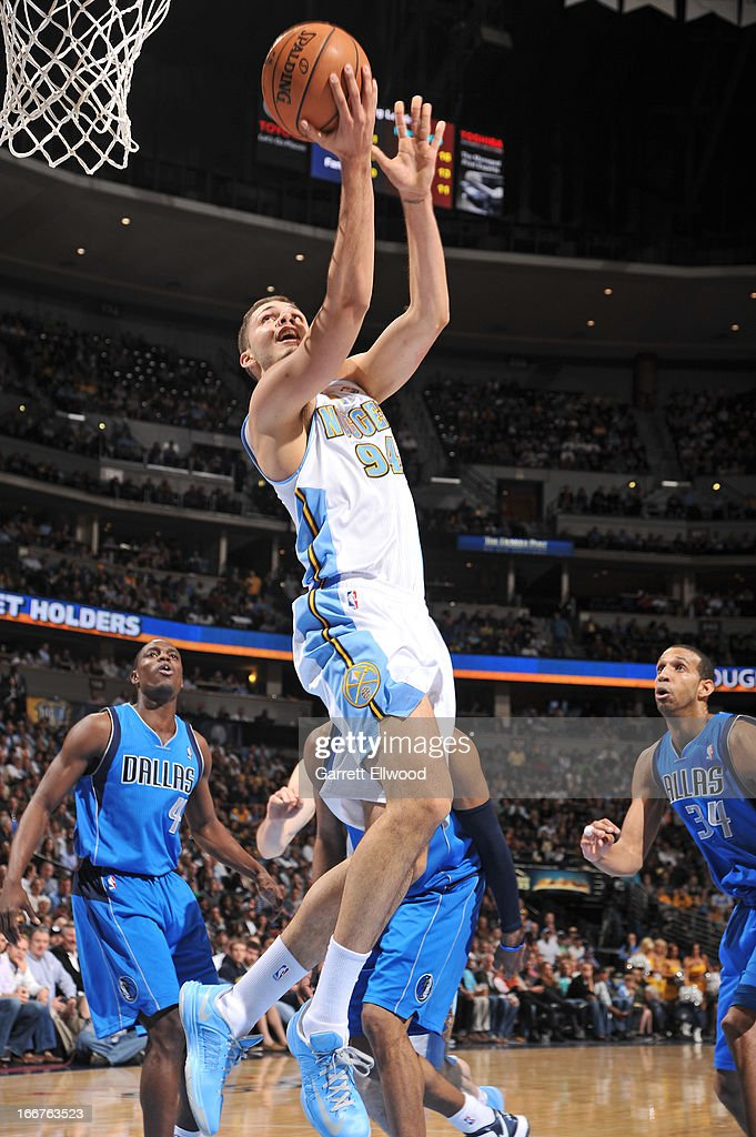 Evan Fournier #94 of the Denver Nuggets goes up for the reverse layup against the Dallas Mavericks on April 4, 2013 at the Pepsi Center in Denver, Colorado.