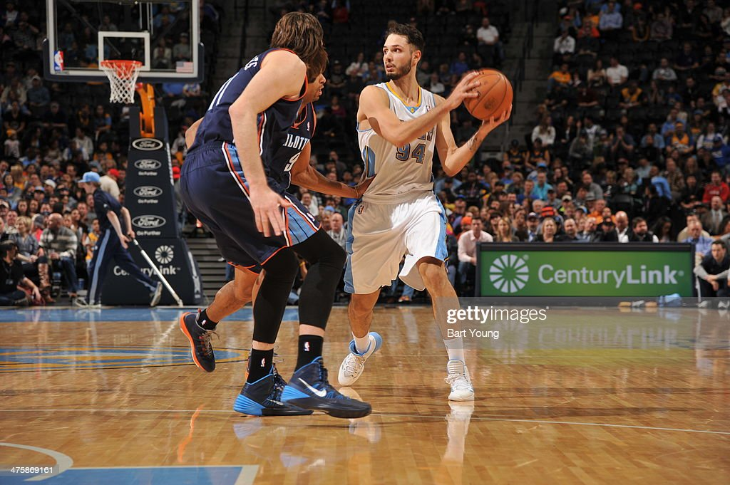 <a gi-track='captionPersonalityLinkClicked' href=/galleries/search?phrase=Evan+Fournier&family=editorial&specificpeople=7285162 ng-click='$event.stopPropagation()'>Evan Fournier</a> #94 of the Denver Nuggets handles the ball against the Charlotte Bobcats on January 29, 2014 at the Pepsi Center in Denver, Colorado.