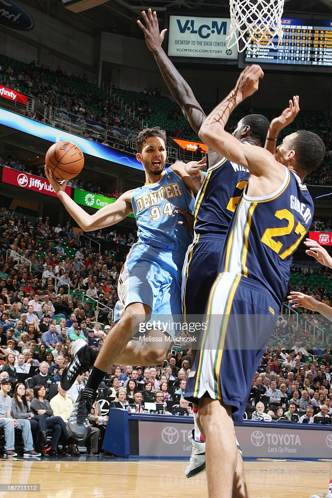 <a gi-track='captionPersonalityLinkClicked' href=/galleries/search?phrase=Evan+Fournier&family=editorial&specificpeople=7285162 ng-click='$event.stopPropagation()'>Evan Fournier</a> #94 of the Denver Nuggets passes the ball against <a gi-track='captionPersonalityLinkClicked' href=/galleries/search?phrase=Marvin+Williams&family=editorial&specificpeople=206784 ng-click='$event.stopPropagation()'>Marvin Williams</a> #2 and Rudy Robert #27 of the Utah Jazz at EnergySolutions Arena on November 11, 2013 in Salt Lake City, Utah.