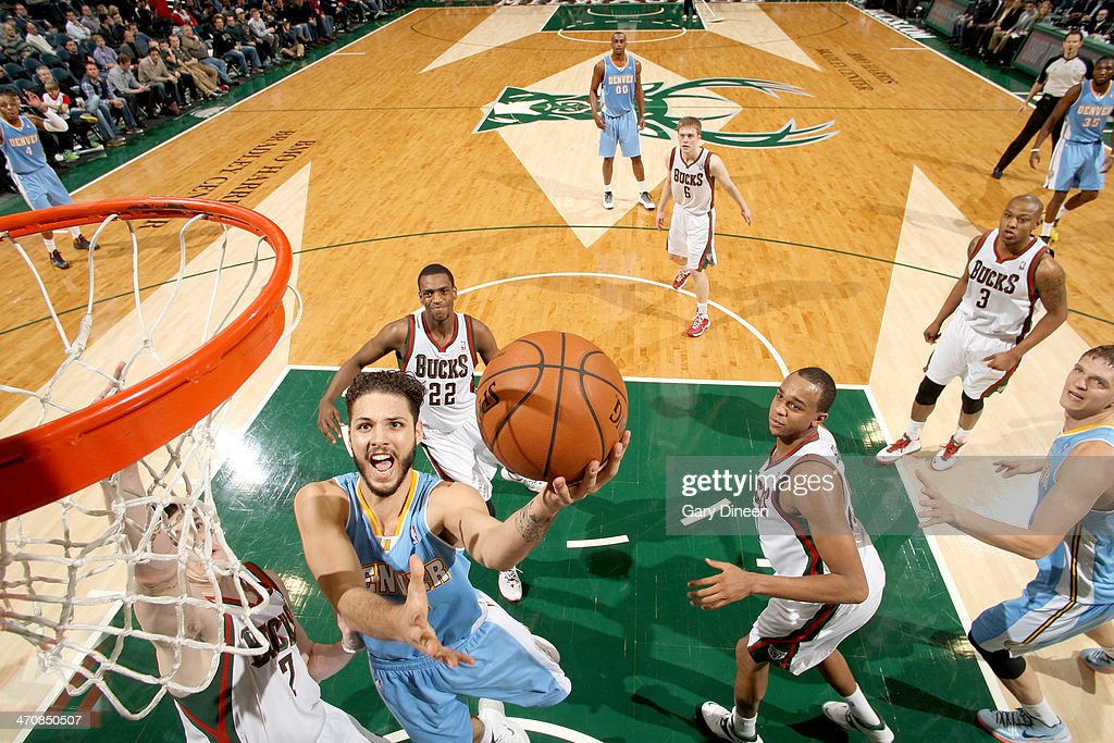 <a gi-track='captionPersonalityLinkClicked' href=/galleries/search?phrase=Evan+Fournier&family=editorial&specificpeople=7285162 ng-click='$event.stopPropagation()'>Evan Fournier</a> #94 of the Denver Nuggets shoots against Ersan Ilyasova #7 of the Milwaukee Bucks on February 20, 2014 at the BMO Harris Bradley Center in Milwaukee, Wisconsin.