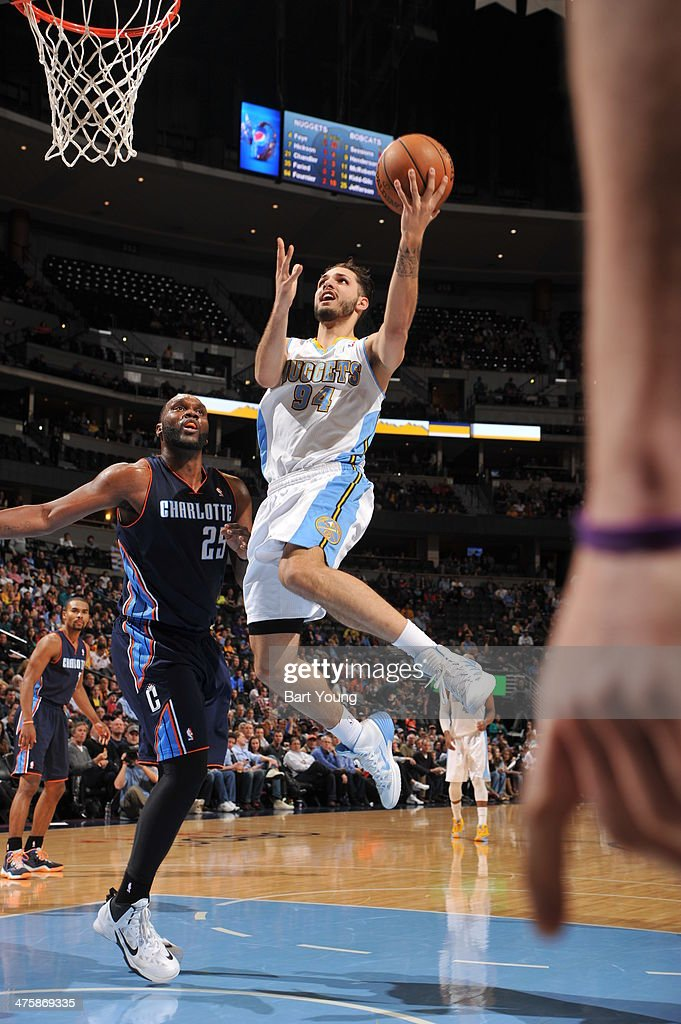 <a gi-track='captionPersonalityLinkClicked' href=/galleries/search?phrase=Evan+Fournier&family=editorial&specificpeople=7285162 ng-click='$event.stopPropagation()'>Evan Fournier</a> #94 of the Denver Nuggets shoots against the Charlotte Bobcats on January 29, 2014 at the Pepsi Center in Denver, Colorado.
