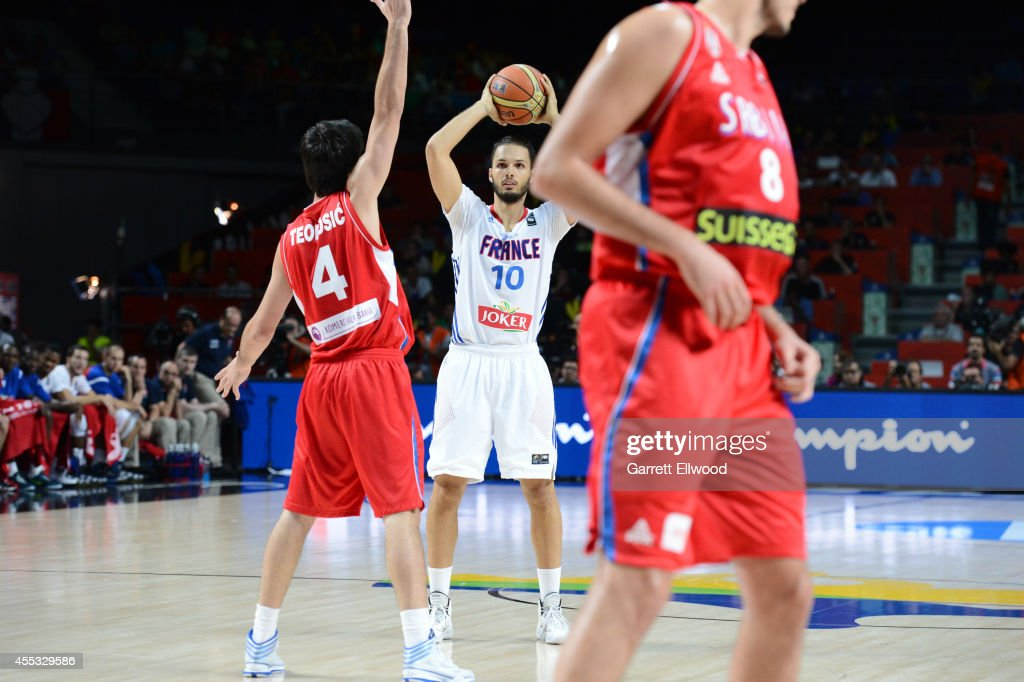 <a gi-track='captionPersonalityLinkClicked' href=/galleries/search?phrase=Evan+Fournier&family=editorial&specificpeople=7285162 ng-click='$event.stopPropagation()'>Evan Fournier</a> #10 of the France National Team passes against <a gi-track='captionPersonalityLinkClicked' href=/galleries/search?phrase=Milos+Teodosic&family=editorial&specificpeople=4453210 ng-click='$event.stopPropagation()'>Milos Teodosic</a> #4 of the Serbia National Team at Palacio de Deportes on September 12, 2014 in Madrid, Spain.