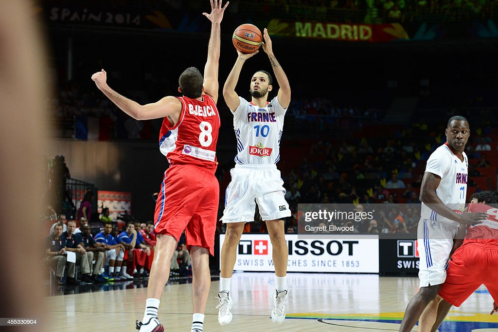 <a gi-track='captionPersonalityLinkClicked' href=/galleries/search?phrase=Evan+Fournier&family=editorial&specificpeople=7285162 ng-click='$event.stopPropagation()'>Evan Fournier</a> #10 of the France National Team shoots against <a gi-track='captionPersonalityLinkClicked' href=/galleries/search?phrase=Nemanja+Bjelica&family=editorial&specificpeople=5625698 ng-click='$event.stopPropagation()'>Nemanja Bjelica</a> #8 of the Serbia National Team at Palacio de Deportes on September 12, 2014 in Madrid, Spain.