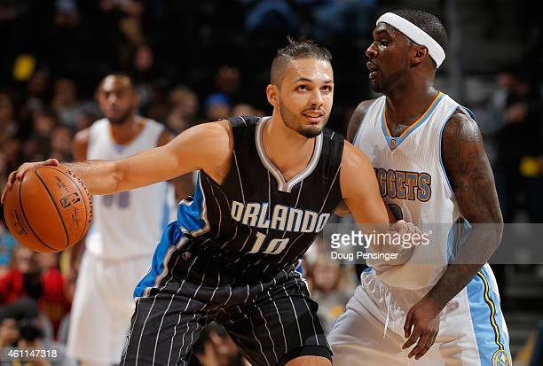 Evan Fournier of the Orlando Magic controls the ball against Ty Lawson of the Denver Nuggets at Pepsi Center on January 7 2015 in Denver Colorado...