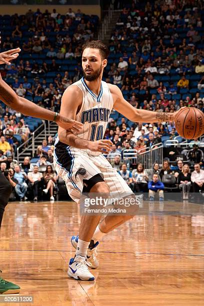 Evan Fournier of the Orlando Magic defends the ball against the Milwaukee Bucks during the game on April 11 2016 at Amway Center in Orlando Florida...