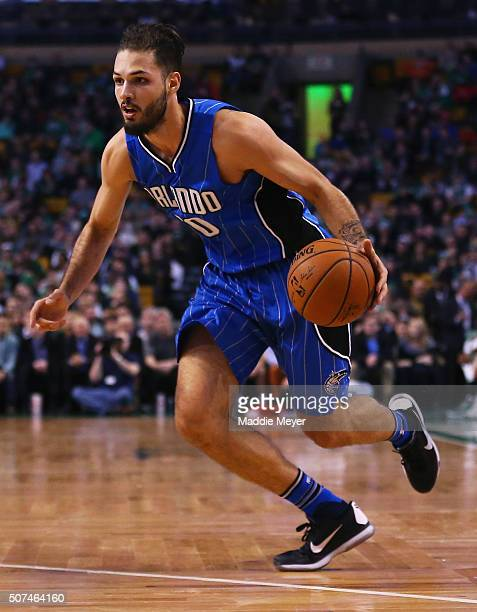Evan Fournier of the Orlando Magic dribbles against the Boston Celtics during the second quarter at TD Garden on January 29 2016 in Boston...