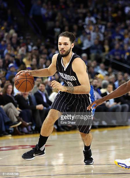 Evan Fournier of the Orlando Magic dribbles the ball against the Golden State Warriors at ORACLE Arena on March 7 2016 in Oakland California NOTE TO...