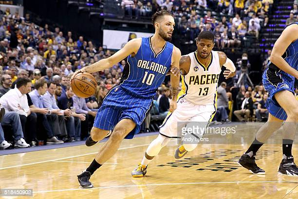 Evan Fournier of the Orlando Magic dribbles the ball during the game against the Indiana Pacers at Bankers Life Fieldhouse on March 31 2016 in...