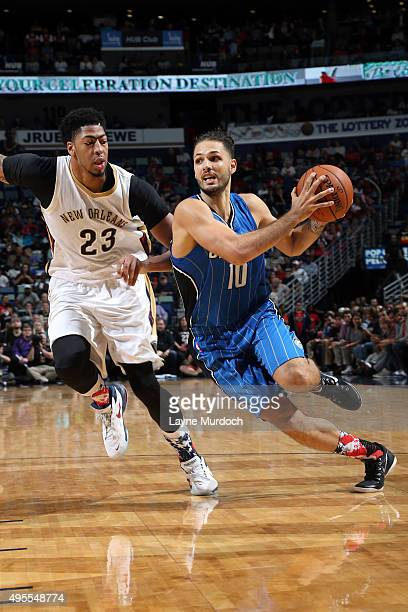 Evan Fournier of the Orlando Magic drives to the basket against Anthony Davis of the New Orleans Pelicans during the game on November 3 2015 at...