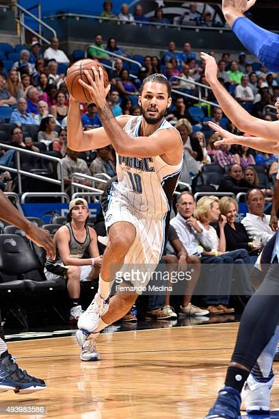 Evan Fournier of the Orlando Magic drives to the basket against the Memphis Grizzlies on October 23 2015 at Amway Center in Orlando Florida NOTE TO...