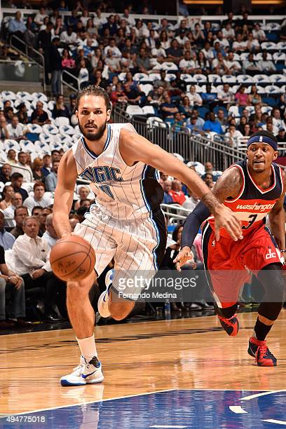 Evan Fournier of the Orlando Magic drives to the basket against the Washington Wizards on October 28 2015 at Amway Center in Orlando Florida NOTE TO...
