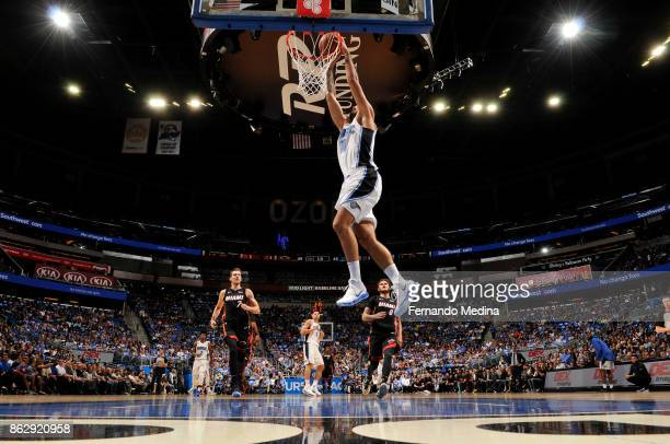 Evan Fournier of the Orlando Magic dunks the ball during the game against the Miami Heat on October 18 2017 at Amway Center in Orlando Florida NOTE...