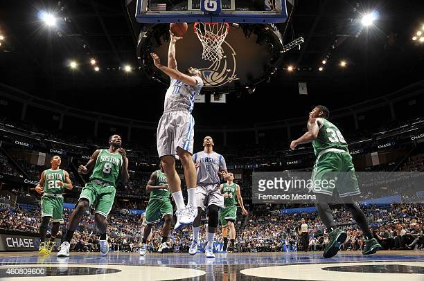 Evan Fournier of the Orlando Magic goes to the basket against the Boston Celtics on December 23 2014 at Amway Center in Orlando Florida NOTE TO USER...