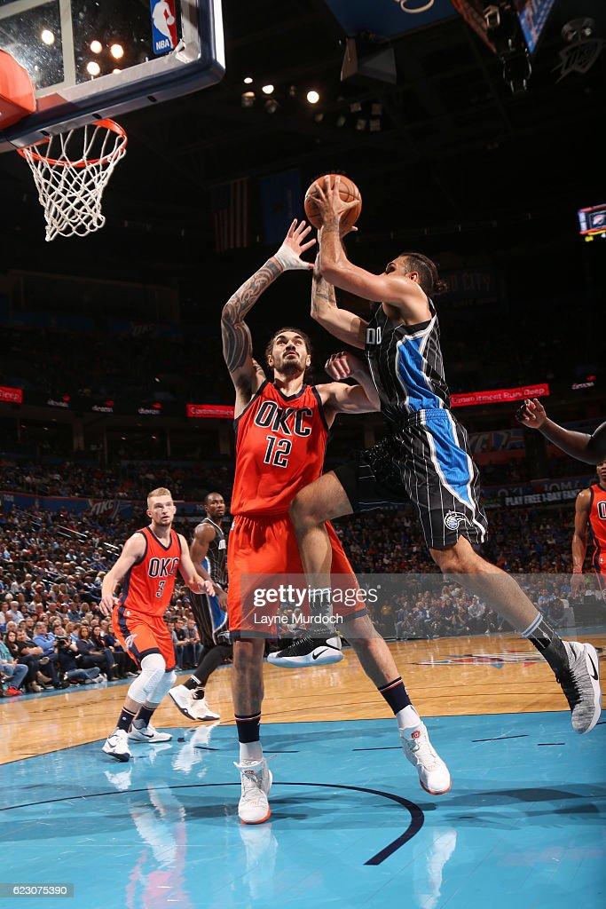 Evan Fournier #10 of the Orlando Magic goes up for a shot against Steven Adams #12 of the Oklahoma City Thunder during a game on November 13, 2016 at Chesapeake Energy Arena in Oklahoma City, Oklahoma.